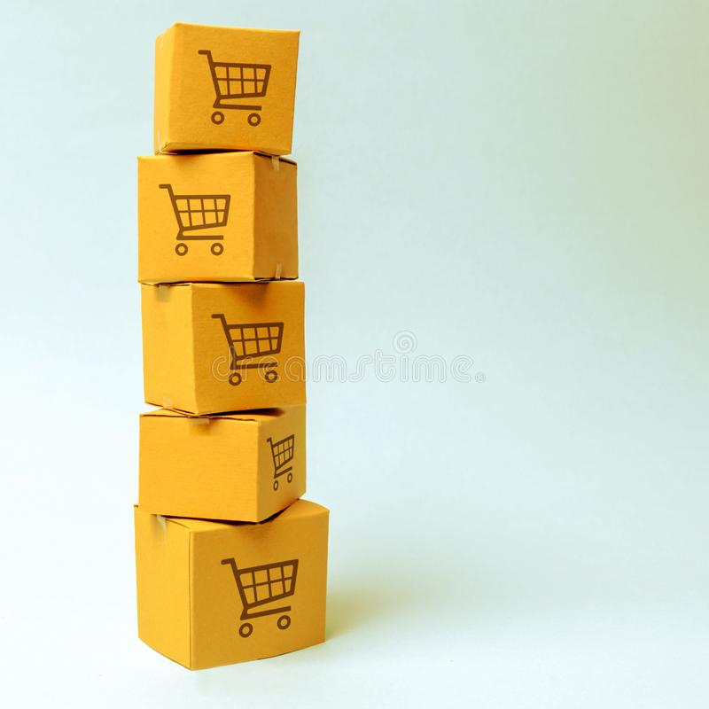 Tower of cardboard boxes with pattern of shopping carts on a blue background. commerce, online shopping. E-commerce, logistics,. Distribution and sales royalty free stock image