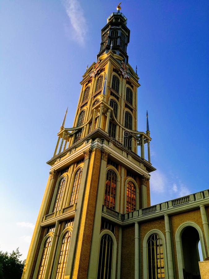 The tower of the Catholic Church in the background of the sky stock image