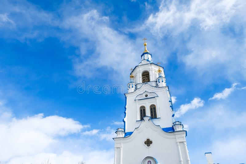 The tower of Church on background of blue sky with clouds. Russia, Tyumen royalty free stock photos