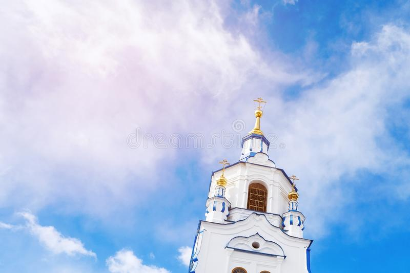 The tower of Church on background of blue sky with clouds. Russia, Tyumen royalty free stock images