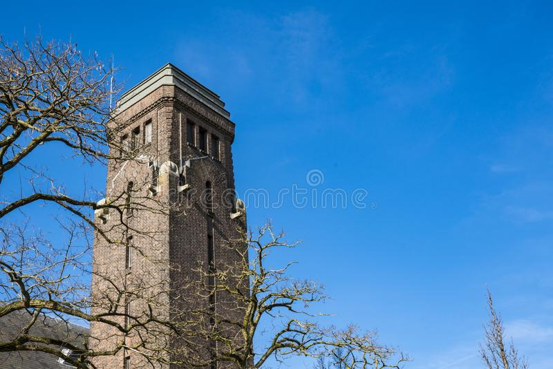 Tower of Church in street Dubbeldamseweg, Singel, in Dordrecht, The Netherlands. Tower of church in street Single, corner Dubbeldamseweg in Dordrecht, The stock photography