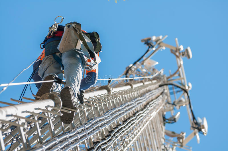 Tower climber. The cellular system stock photo