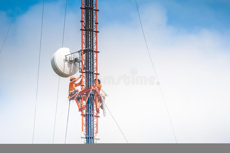 Tower climber and working stock photography