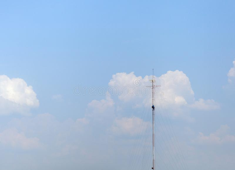 Tower climber and working on cellular tower system. extreme height stock image