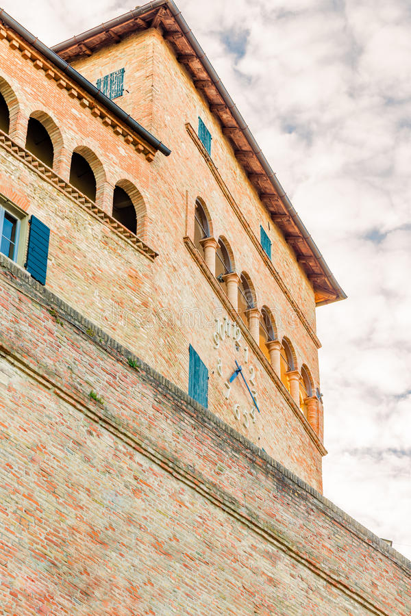 Tower with clock. Medieval castle tower with arches with clock stock photo