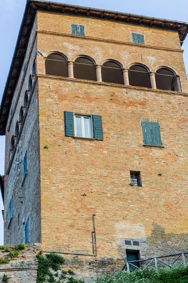 Tower with clock. Medieval castle tower with arches with clock royalty free stock photography