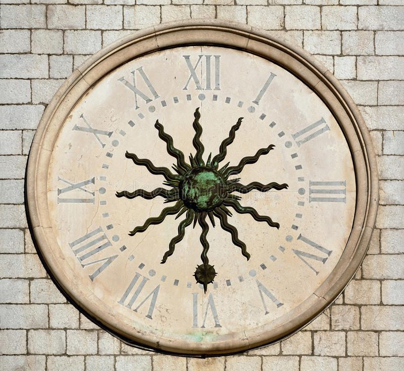 Tower clock. Old stone church tower clock royalty free stock photography