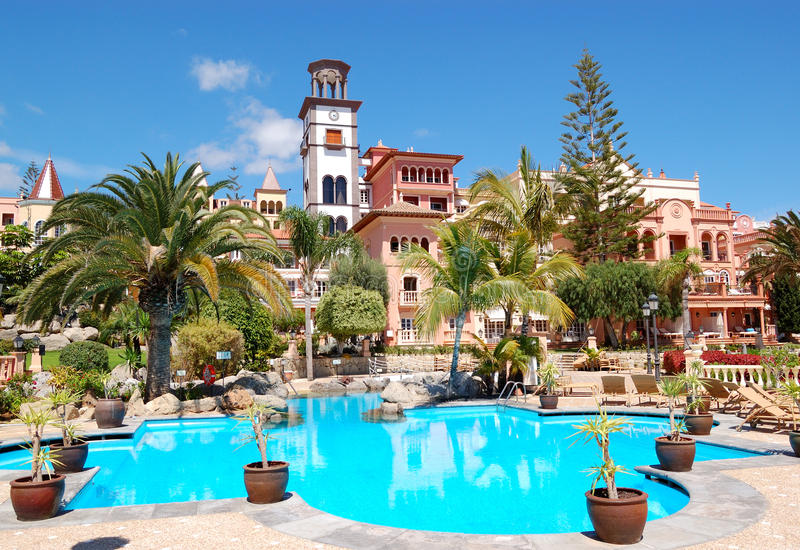 Tower with clock and swimming pool. At the luxury hotel, Tenerife island, Spain stock photos