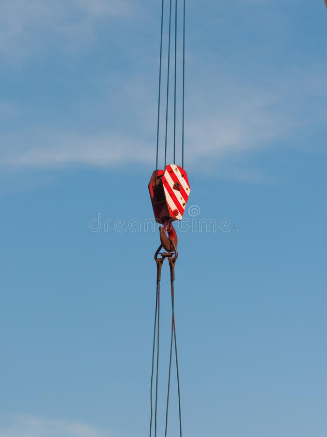 Tower Crane. Hook of Tower Crane on a Cloudy Beautiful Day stock image