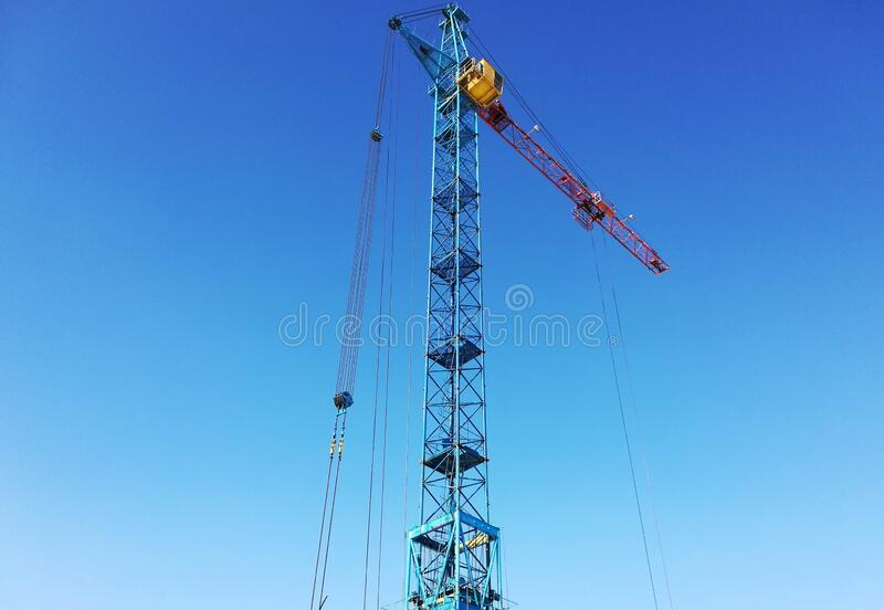 Tower crane on a background of blue sky stock image