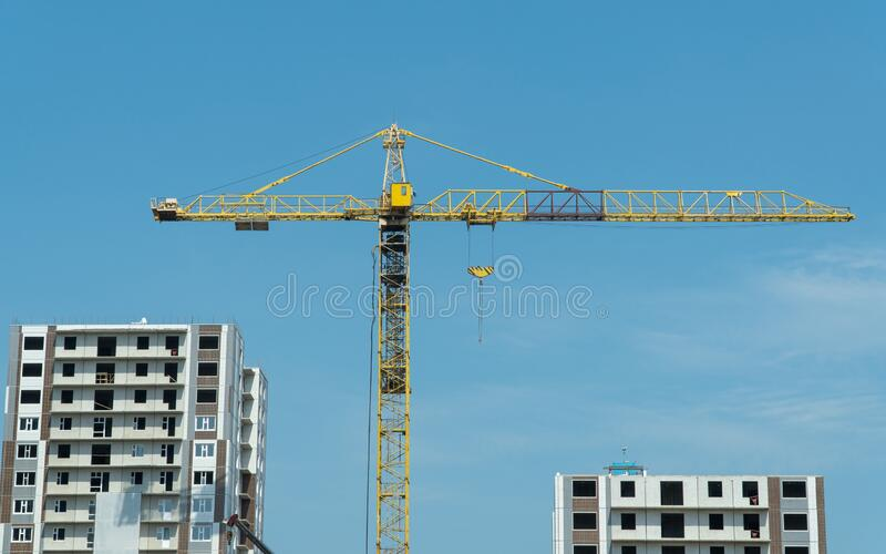 Tower crane on the construction of high-rise buildings. royalty free stock photography