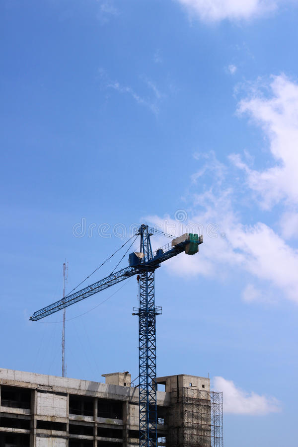 Tower crane at construction site royalty free stock photography