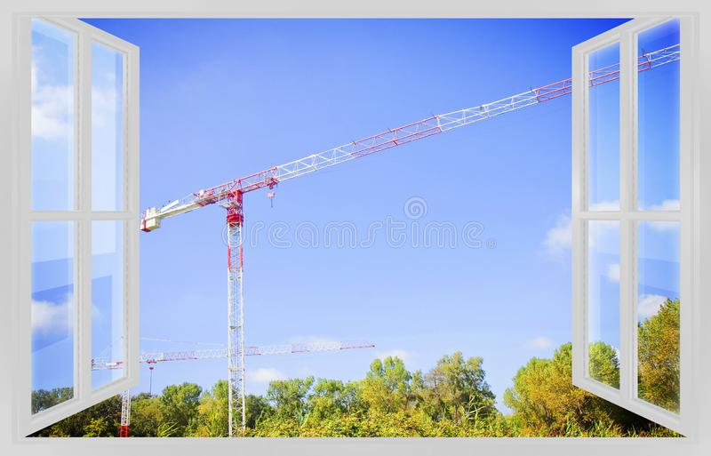 Tower crane in a construction site - 3D rendering of an open window concept image royalty free stock photography