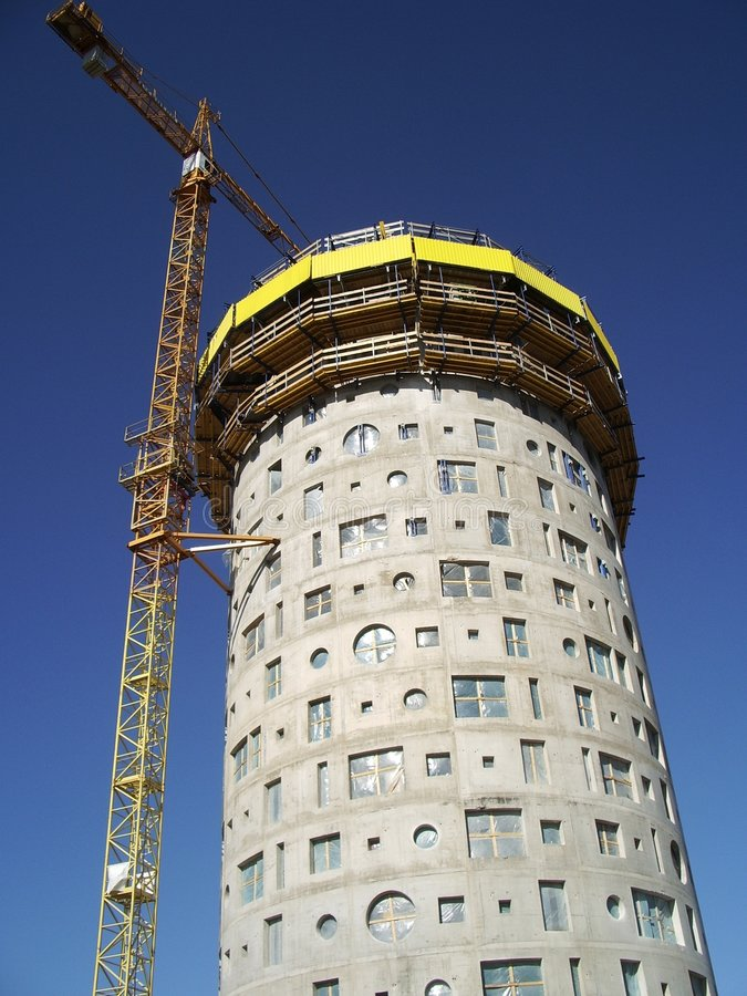 Tower crane and house-building stock photography