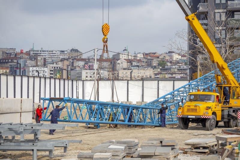 Tower crane installation work. BELGRADE, SERBIA - APRIL 11, 2019: Tower crane installation work at construction site. Erecting and assembly crane stock photos