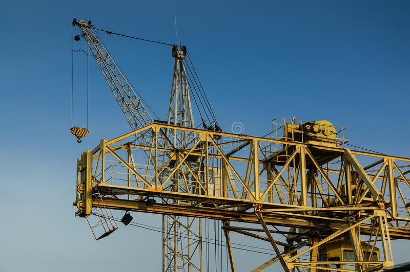 Tower crane. Lifting machines, tower crane on a blue sky royalty free stock photography