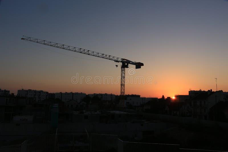 Tower crane in the light of the rising sun. Tower crane at the construction site in the light of the rising sun stock photos