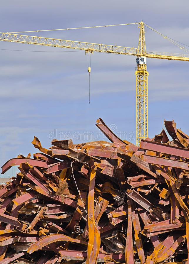 Tower Crane and Pile of Twisted Girders royalty free stock photos