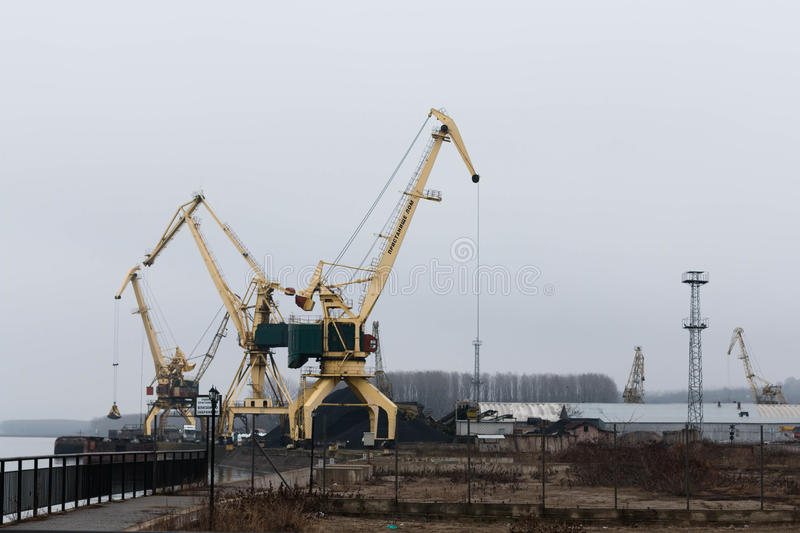Tower crane at the port of Danube River in Lom, Bulgaria. Crane at the port of Danube River in Lom, Bulgaria stock photography