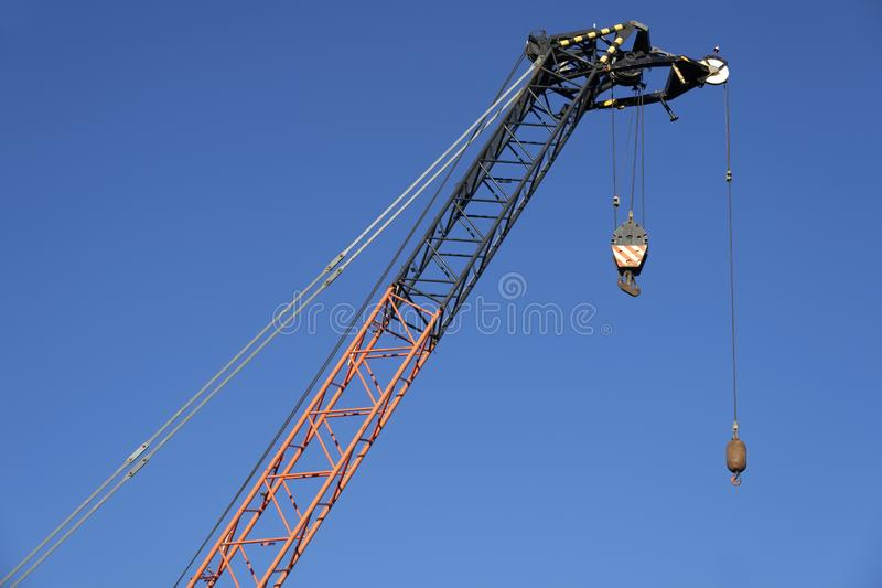 Tower crane tall high in sky yellow colour for construction site and shipbuilding close up of structure stock photos