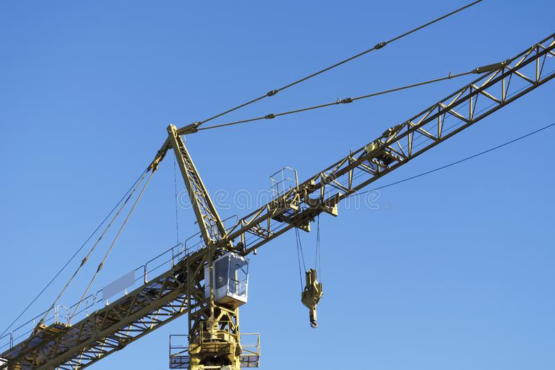 Tower crane tall high in sky yellow colour for construction site and shipbuilding close up of structure stock images