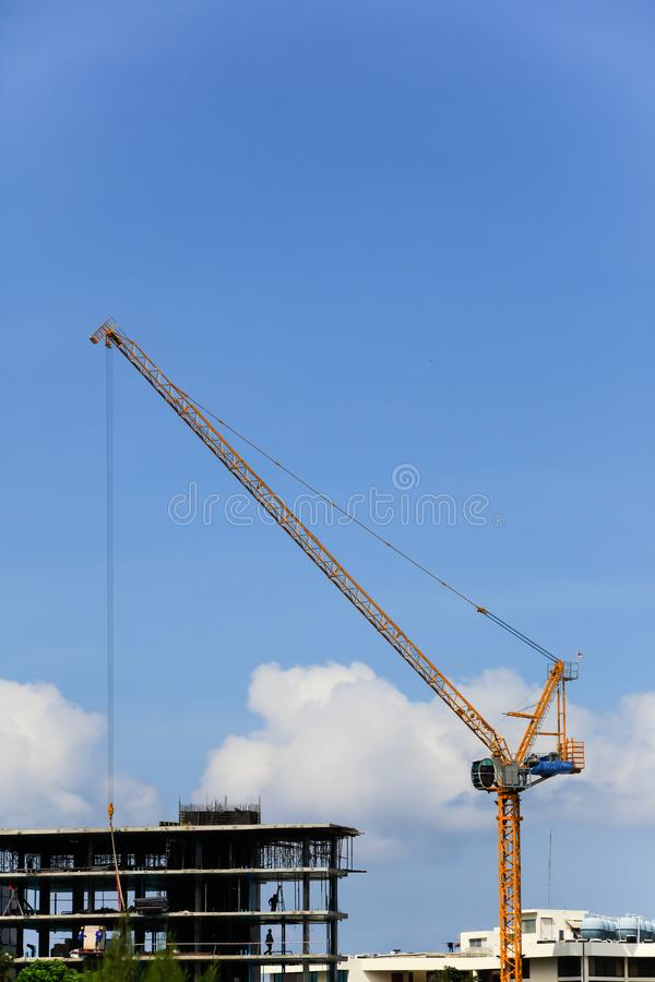 Tower cranes. Architecture, blue, business, concrete, construction, development, engineering, equipment, heavy, industrial, industry, lift, lifting, machine royalty free stock image