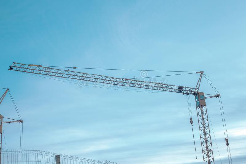 Tower cranes by blue cloud sky royalty free stock images