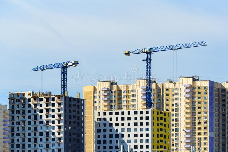 Tower cranes build a modern houses stock photos