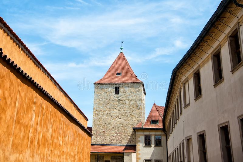 Tower and fortification wall in Prague, Czech Republic. On sunny day on blue sky background. Travelling, wanderlust, vacation concept royalty free stock photo