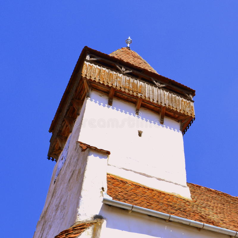 Tower in the fortified saxon medieval church Homorod, Transylvania. The villagers started building a single-nave Romanesque church, which is uncommon for a Saxon stock photo