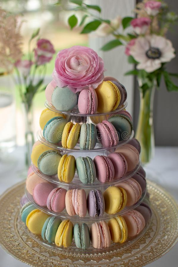 Tower of french macarons in pastel colors. Macarons are a part of a dessert table at a wedding. Tower of pastel colored french macarons in pastel colors royalty free stock photos