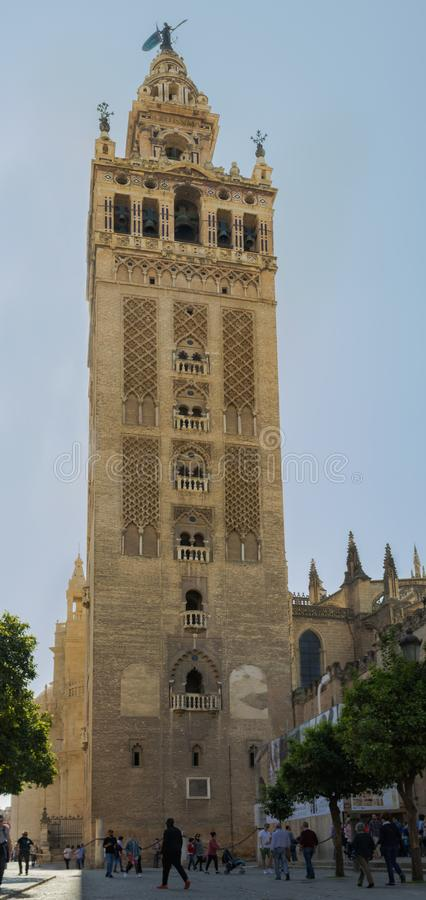 Tower of the Giralda of Seville, Spain. Panoramic view of the Giralda tower in Seville, Spain, March 3, 2019 royalty free stock images