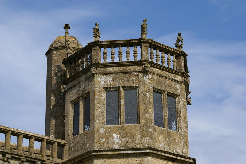 Tower with griffin statues, Lacock Abbey, in Lacock Wiltshire, England. The British abbey was founded in the early 13th century by Ela, Countess of Salisbury, as stock image