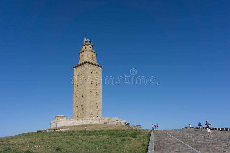 Tower of Hercules. LA CORUNA, SPAIN - AUGUST 20, 2016: The Tower of Hercules with blue sky. The tower is the oldest Roman lighthouse in use today and overlooks stock photo
