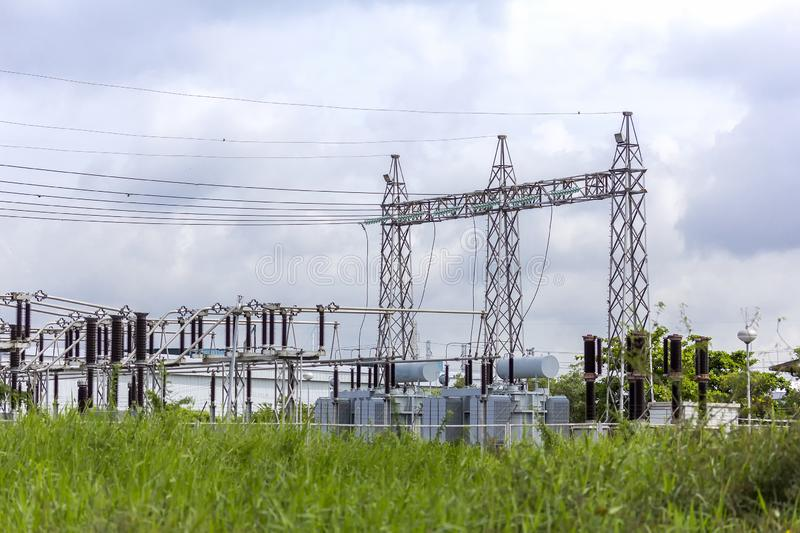 High voltage electric power substation with cloudy dark sky background. Tower of high voltage electric power at substation with cloudy dark sky background stock photography