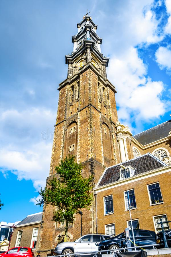 Tower of the Historic Westerkerk in Amsterdam near the Anne Frank House at the Prinsengracht in Amsterdam. Amsterdam, the Netherlands - Sept 28, 2018: Tower of royalty free stock images