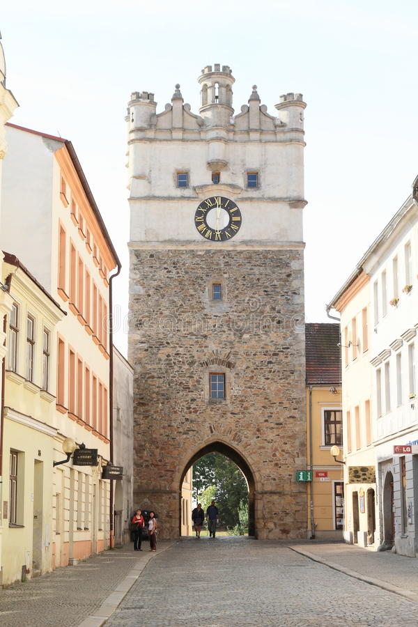 Tower In Jihlava. Stone gothic tower with clocks and entrance gate in city Jihlava Czech Republic royalty free stock image