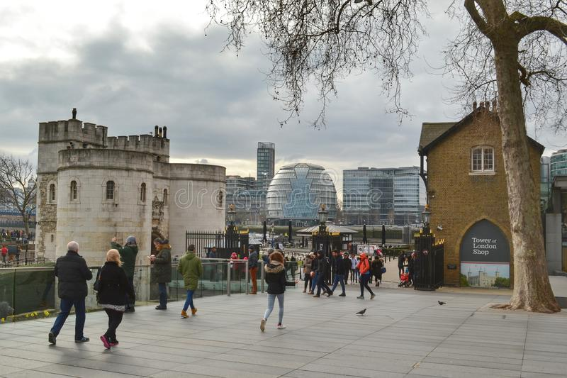 Tower London City Hall. Middle Tower of Tower of London , City Hall on the far bank of river Thames and Tower of London shop on the right stock photos