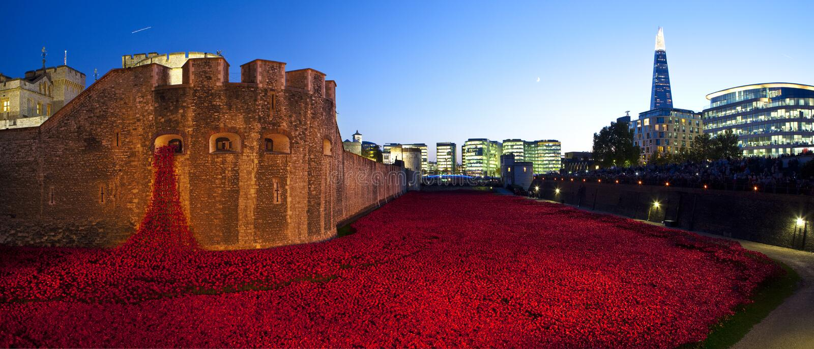 Tower of London and Poppies at Dusk. LONDON, UK - OCTOBER 27TH 2014: A panoramic view of the ceramic Poppies of the 'Blood Swept Lands and Seas of Red' royalty free stock photography