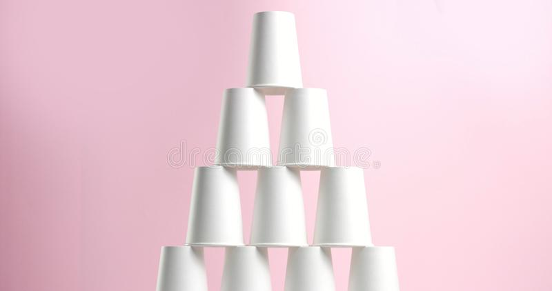 Tower made of white paper cups royalty free stock images