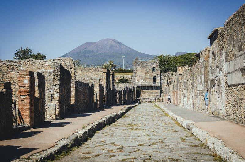 Tower of Mercury with Volcano Mount Vesuvius in the background,. Pompeii. Pompeii was destroyed by the eruption of the volcano Vesuvius in AD 79 stock image