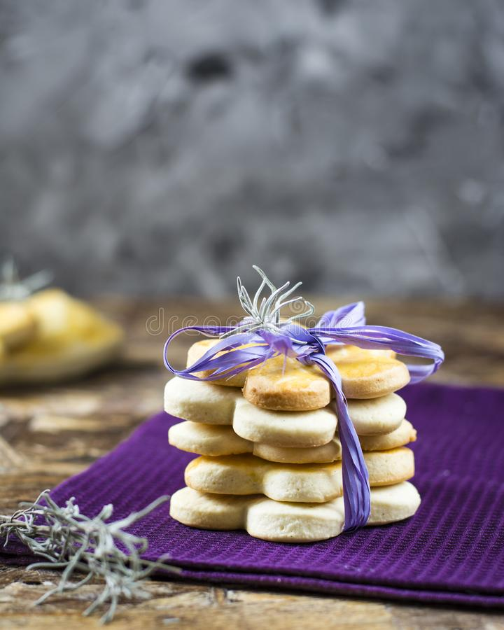 Tower of milk spring cookies with lavender in form of flower for women`s day, mother`s day, 8 march and grandmother`s day. stock image