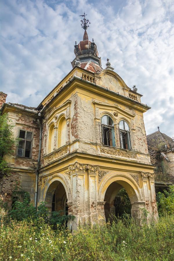Tower of the old palace near city of Vrsac, Serbia. Tower of the ancient castle with broken windows near city of Vrsac, Serbia royalty free stock photo