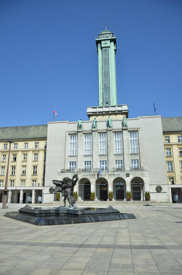 Tower of Ostrava town hall. Town hall, Ostrava city with copper tower and statue a head of. Blue sky in background stock image