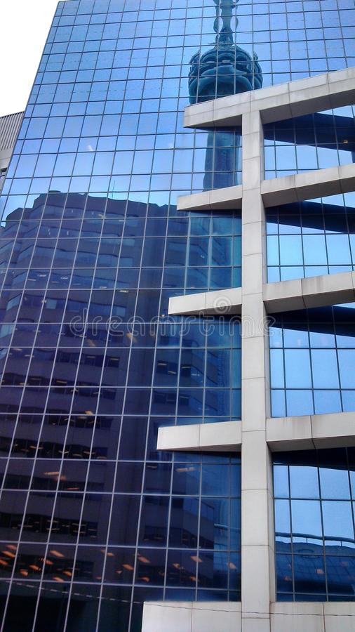 Tower reflected in Hi-rise stock image