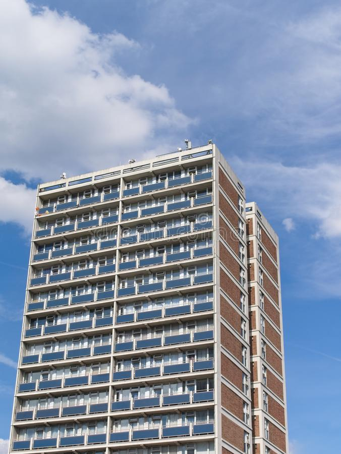 Tower social housing building against blue sky with clouds royalty free stock photo