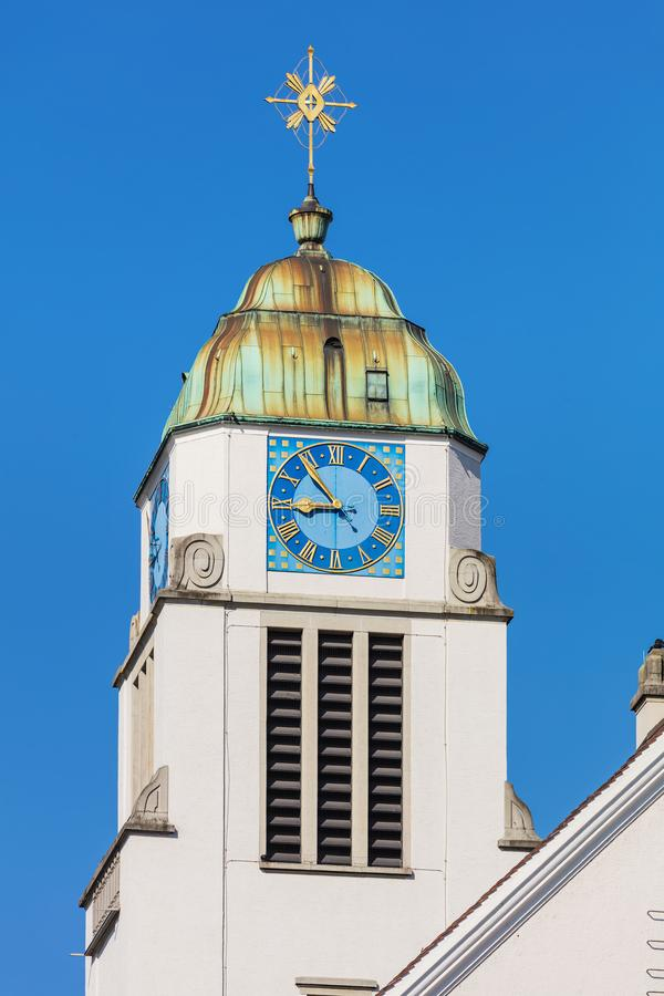 Tower of the St. Agatha church in the Swiss town of Dietikon royalty free stock image