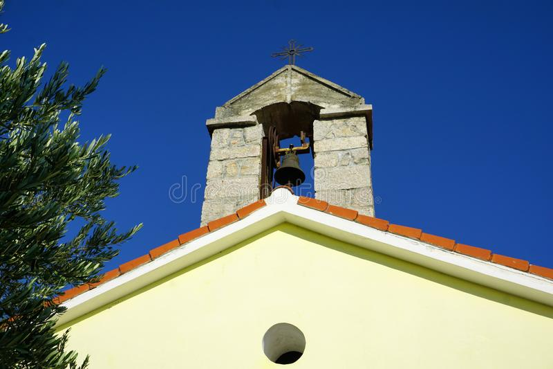 The tower of St. Anthony Church in Prizna, in front of the Island of Pag in Croatia stock photo