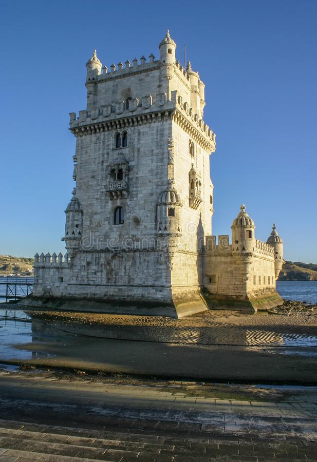 Tower of St Vincent Torre de Belem, with river Tagus in backgr. Ound in afternoon sun light. Lisbon, Portugal royalty free stock photos
