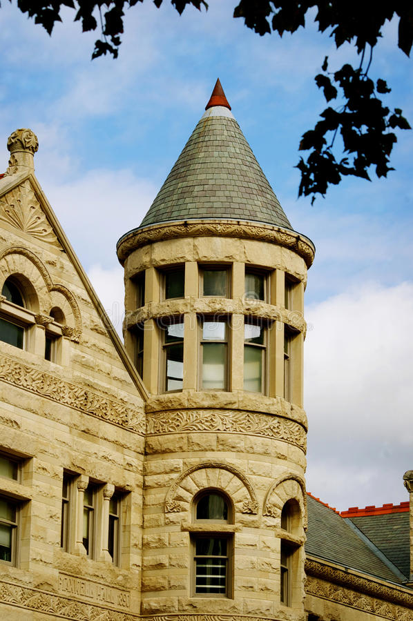 Tower on stone building at Indiana University. Tower with red tip on a stone building at Indianan University in Bloomington, Indiana stock images